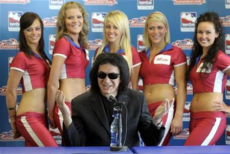 Kiss lead singer Gene Simmons speaks to the media before his grand marshalling duties at the Edmonton Indy Grand Prix July 26, 2008. REUTERS/Dan Riedlhuber