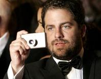 <p>Brett Ratner takes a photo on the red carpet as he arrives for the screening of his non competition film 'X-Men: The Last Stand' at the 59th Cannes Film Festival May 22, 2006. REUTERS/Mario Anzuoni</p>