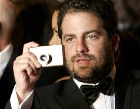 Brett Ratner takes a photo on the red carpet as he arrives for the screening of his non competition film 'X-Men: The Last Stand' at the 59th Cannes Film Festival May 22, 2006. REUTERS/Mario Anzuoni
