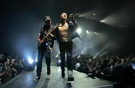 Chris Martin (R) and Jonny Buckland of Coldplay perform during a concert as part of their European Viva La Vida tour in Budapest on September 23, 2008. REUTERS/Karoly Arvai