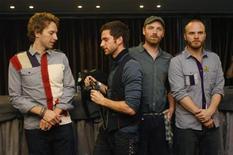 """<p>I Coldplay durante la presentazione del loro ultimo album """"Viva la Vida"""" a Barcellona, nel giugno del 2008. REUTERS/Albert Gea</p>"""