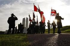 <p>A colour party marches away from the Canadian National Vimy Memorial following a Remembrance Day ceremony to commemorate members of the armed forces who were killed since World War One in Vimy, France, November 9, 2008. REUTERS/Chris Wattie</p>