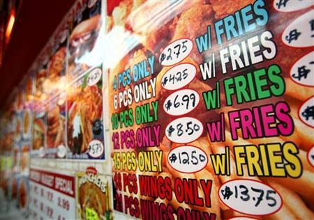 A menu for fried chicken and french fries is displayed on a wall at a fast food restaurant in New York, October 30, 2006. REUTERS/Shannon Stapleton
