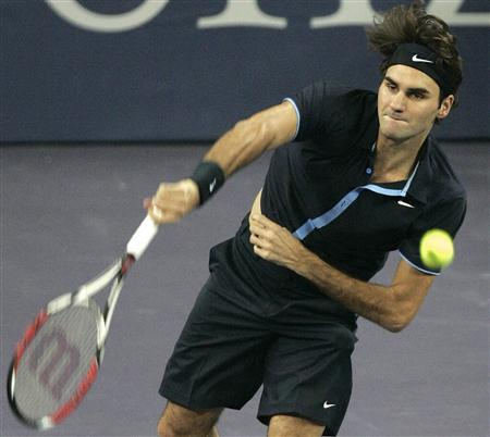 Roger Federer of Switzerland serves to Radek Stepanek of Czech Republic during their Masters Cup tennis match in Shanghai November 12, 2008. REUTERS/Aly Song