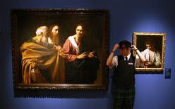 "<p>A gallery attendant poses for photographers as he stands next to the ""The Calling of Saints Peter and Andrew"" painting by Caravaggio (L), during a photocall for the forthcoming ""The Art of Italy in the Royal Collection"" exhibition at The Queens Gallery, Palace of Holyroodhouse in Edinburgh, Scotland November 12, 2008. REUTERS/David Moir</p>"