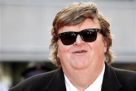 U.S. director Michael Moore arrives before the world premiere screening of ''Indiana Jones and the Kingdom of the Crystal Skull'' by U.S. director Steven Spielberg at the 61st Cannes Film Festival in this file photo from May 18, 2008. REUTERS/Vincent Kessler
