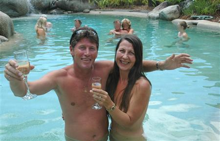 Tony Fox, the owner of the White Cockatoo resort in Mossman, in tropical Queensland state, and his wife Lenore pose in this undated handout photo at the resort. REUTERS/White Cockatoo/Handout IMAGE PIXELATED AT SOURCE