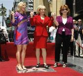 <p>ABC talk show host and newswoman Barbara Walters (C) stands atop her newly unveiled star on the Hollywood Walk of Fame with her co-hosts from her talk show 'The View' Elisabeth Hasselbeck (L) and Joy Behar in Hollywood,California June 14, 2007. REUTERS/Fred Prouser</p>