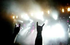 <p>Fans raise their hands during the Metalway Festival in Gernika, northern Spain, August 13, 2005. REUTERS/ Vincent West</p>