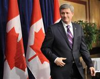 <p>Canada's Prime Minister Stephen Harper leaves after speaking with the media at the Conservative Party of Canada's National Policy Convention in Winnipeg, Manitoba on November 14, 2008. REUTERS/Fred Greenslade</p>