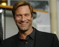 <p>Aaron Eckhart smiles in this file photo. REUTERS/Mario Anzuoni</p>