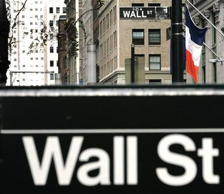 Signs marking the entrance to Wall Street are seen in New York October 6, 2008. REUTERS/Shannon Stapleton