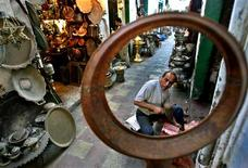 <p>A shopkeeper works outside his shop at the old market in the Libyan capital of Tripoli in this April 15, 2006 file photo. As economic barriers fall between Libya and the West, a boom-town atmosphere fed by the novelty of consumer culture has gripped its capital Tripoli. Hotel rooms are in short supply as foreigners flock to the Mediterranean port city to seal business deals made possible by the OPEC member country's recovery from years of sanctions. REUTERS/Zohra Bensemra</p>