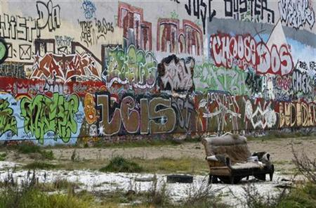 A Graffiti painted wall is pictured on the site of the 'Tacheles' art house, a cultural centre in the ruins of a former department store in Berlin, November 4, 2008. REUTERS/Fabrizio Bensch