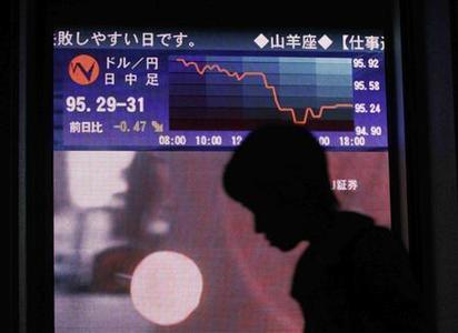 A woman walks past an electronic board showing an exchange rate between Japanese yen and U.S. dollar outside of a brokerage in Tokyo November 20, 2008. REUTERS/Kim Kyung-Hoon