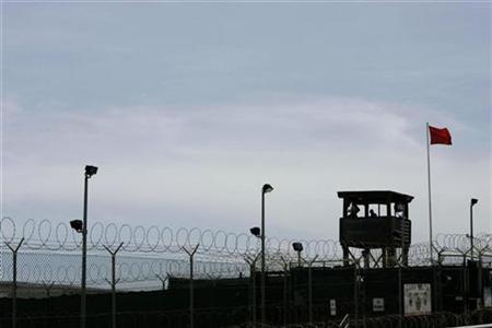 A guard tower of Camp Delta is seen at the Guantanamo Bay Naval Station in Guantanamo Bay, Cuba September 4, 2007. REUTERS/Joe Skipper