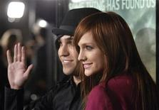 "<p>Musicians Ashlee Simpson (R) and Pete Wentz attend the premiere of ""Cloverfield"" in Los Angeles January 16, 2008. REUTERS/Phil McCarten</p>"