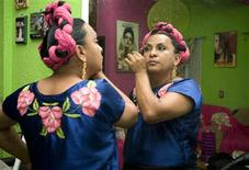 <p>A man, dressed in the traditional costume of a Zapotec woman, plucks his eyebrows at the town of Juchitan in southern Mexico, November 22, 2008. Anthropologists say the tradition of blurring genders among Mexico's indigenous population is centuries old but has been revived in recent decades due to the gay pride movement. Picture taken on November 22, 2008. REUTERS/Stringer</p>