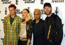 <p>Adrian Young (L), Gwen Stefani, Tony Kanal and Tom Dumont of No Doubt visit the press room in Anaheim on February 18, 2005. REUTERS/Michael Buckner</p>