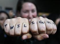"<p>Fan Noelle Buffam displays words written on her fists at the premiere of the movie ""Twilight"" at the Mann Village and Bruin theatres in Westwood, California November 17, 2008. REUTERS/Mario Anzuoni</p>"