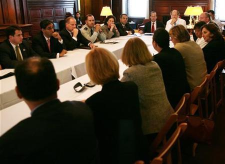 New Jersey Governor Jon Corzine (top R) presides over a meeting of his cabinet at the Statehouse inTrenton, in a file photo. REUTERS/Jeff Zelevansky