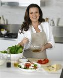 <p>Donny Hay cooks in the kitchen at her offices in Surry Hill, Sydney in a September 2008 photo. REUTERS/Gary Heery Photography/Handout</p>