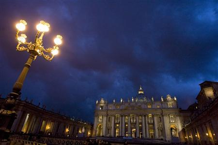 St. Peter's Basilica is seen lit in the evening at the Vatican November 25, 2008. The Vatican is set to go green on Wednesday when technicians throw the switch on a new solar energy system to power several key building and commit itself to renewable energy for 20 percent of its needs by 2020. REUTERS/Tony Gentile