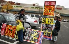 "<p>Two workers stand with going out of business sale signs in front of the ""Linens n Things"" store that is closing at the Paramus Towne Square mall in Paramus, New Jersey, November 18, 2008. Shopping centers, a category that includes strip malls, are doing much worse than that, reporting vacancy rates of 9.4 percent. Larger, enclosed malls are doing better, with vacancy rates of about 3.9 percent. The store closings have come as the U.S. economic downturn forces retailers to scale back expansion plans, close outposts or file for bankruptcy protection. The trend is expected to accelerate as the financial crisis has tightened credit, say retail analysts and restructuring experts. REUTERS/Mike Segar</p>"