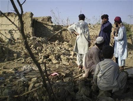 Tribesmen gather at a site of a missile attack on the outskirts of Miranshah, near the Afghan border, October 12, 2008. REUTERS/Haji Mujtaba