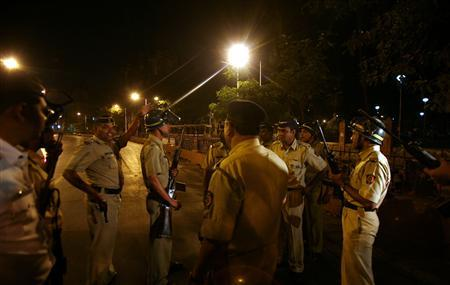 Police stand guard after shooting took place inside a railway station in Mumbai November 26, 2008. REUTERS/Punit Paranjpe