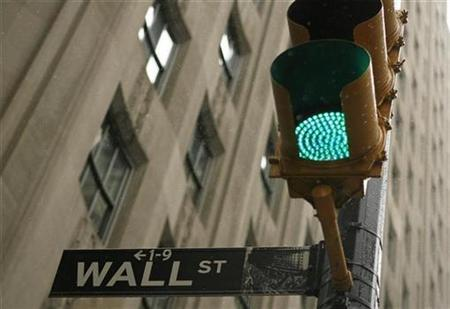 A sign is pictured on Wall St. near the New York Stock Exchange in New York, November 25, 2008. REUTERS/Lucas Jackson