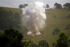 <p>Cluster bomblets are destroyed at a farm in Xiengkhuang in Laos in this undated handout photo. Imagine growing up in a country where the equivalent of a B52 planeload of cluster bombs was dropped every eight minutes for nine years. Welcome to Laos, a country with the unwanted claim of being the most bombed nation per capita in the world. To match feature LAOS-CLUSTERBOMBS REUTERS/Stanislas Fradelizi/Handout</p>