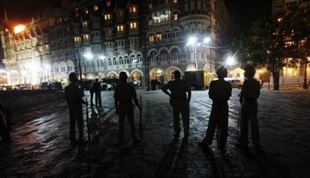 Policemen stand guard outside the Taj Hotel in Mumbai November 27, 2008. REUTERS/Arko Datta