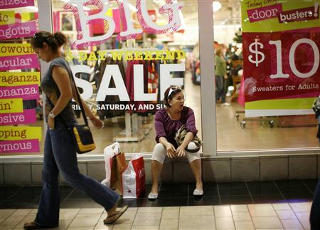 A woman rests after shopping at the Dolphin Mall in Miami November 28, 2008. REUTERS/Carlos Barria