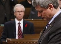 <p>Liberal leader Stephane Dion looks on as Canadian Prime Minister Stephen Harper speaks during Question Period in the House of Commons on Parliament Hill in Ottawa December 1, 2008. REUTERS/Chris Wattie</p>