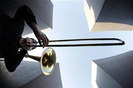 A member of Germany's Kammersymphoniker Berlin orchestra plays the trombone as he warms up prior to the first concert at the Holocaust Memorial in Berlin May 9, 2008. REUTERS/Johannes Eisele
