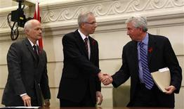 <p>Liberal leader Stephane Dion (C) shakes hands with Bloc Quebecois leader Gilles Duceppe (R) as New Democratic Party leader Jack Layton watches during a news conference on Parliament Hill in Ottawa December 1, 2008. REUTERS/Chris Wattie</p>