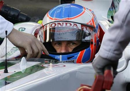 Honda Formula One driver Jenson Button sits in his car during a F1 testing session at the Catalonia racetrack in Montmelo, near Barcelona, November 19, 2008. REUTERS/Gustau Nacarino