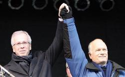<p>Liberal Leader Stephane Dion (L) and New Democratic Party leader Jack Layton (R) greet supporters during a pro-coalition government rally at Nathan Phillips Square in Toronto, December 6, 2008. REUTERS/Mike Cassese</p>