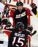 <p>Ottawa Senators' Jason Spezza (top) celebrates his second goal against the Pittsburgh Penguins with teammate Dany Heatley during the second period of their NHL game in Ottawa December 6, 2008. REUTERS/Blair Gable</p>
