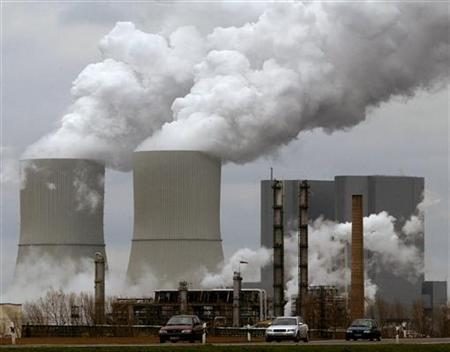 Cars drive past a plant of U.S. chemical producer Dow near the eastern German village of Lippendorf south of Leipzig March 25, 2004. REUTERS/Arnd Wiegmann REUTERS