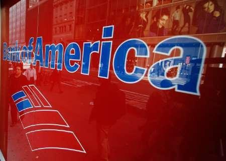 Pedestrians and advertisements can be seen reflected in the windows of a Bank of America branch in New York, October 8, 2008. REUTERS/Lucas Jackson