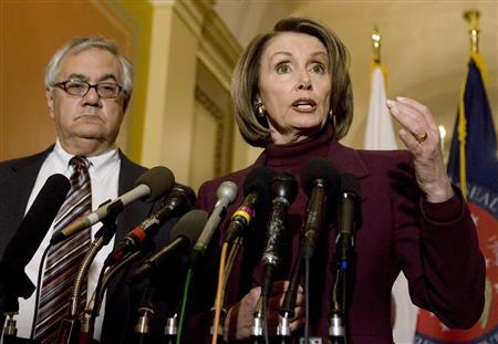 U.S. Speaker of the House Nancy Pelosi (R) stands next to House Financial Services Committee Chairman Rep. Barney Frank (D-Ma) as she talks about the progress of the Detroit auto makers bailout package on Capitol Hill in Washington, December 8, 2008. REUTERS/Larry Downing
