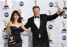 "<p>Tina Fey and Alec Baldwin hold their Emmys as outstanding lead actress and actor in comedy series for ""30 Rock"" at the 60th annual Primetime Emmy Awards in Los Angeles September 21, 2008. REUTERS/Mike Blake</p>"