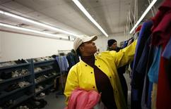 <p>Colis Mayor looks for clothes at the Capuchin Soup Kitchen service center, where hundreds of people receive food and supplies everyday, in Detroit, Michigan, December 9, 2008. REUTERS/Carlos Barria</p>