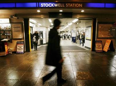A pedestrian passes in front of the entrance to Stockwell tube station inside which Jean Charles de Menezes was shot over three years ago, after the inquest into Menezes' death returned an open verdict in London December 12, 2008. Menezes of Brazil who was mistaken by British police for a suicide bomber and shot dead on a London Underground train was not the victim of a ''lawful killing'', an inquest jury decided on Friday. REUTERS/Andrew Winning