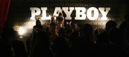 People attend a Playboy magazine party sponsored by a whisky brand in Caracas October 11, 2007. REUTERS/Jorge Silva