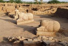 <p>Three ancient statues are seen at a dig at el-Hassa, the site of a Meroitic town in Sudan in this undated handout photograph. Archaeologists said on Tuesday they had discovered three ancient statues in Sudan with inscriptions that could bring them closer to deciphering one of Africa's oldest languages. REUTERS/René-Pierre Dissaux/Section Française de la Direction des Antiquités du Soudan/Handout</p>