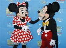 <p>Disney characters Mickey Mouse (R) and Minnie Mouse pose at the premiere of the Disney Channel movie 'High School Musical 2' at Downtown Disney in Anaheim, California August 14, 2007. REUTERS/Fred Prouser</p>