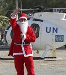 <p>A U.N. aid worker dressed as Santa Claus arrives by helicopter to distribute gifts to Greek and Turkish Cypriot children in Pyla Larnaca December 19, 2008. REUTERS/Andreas Manolis</p>